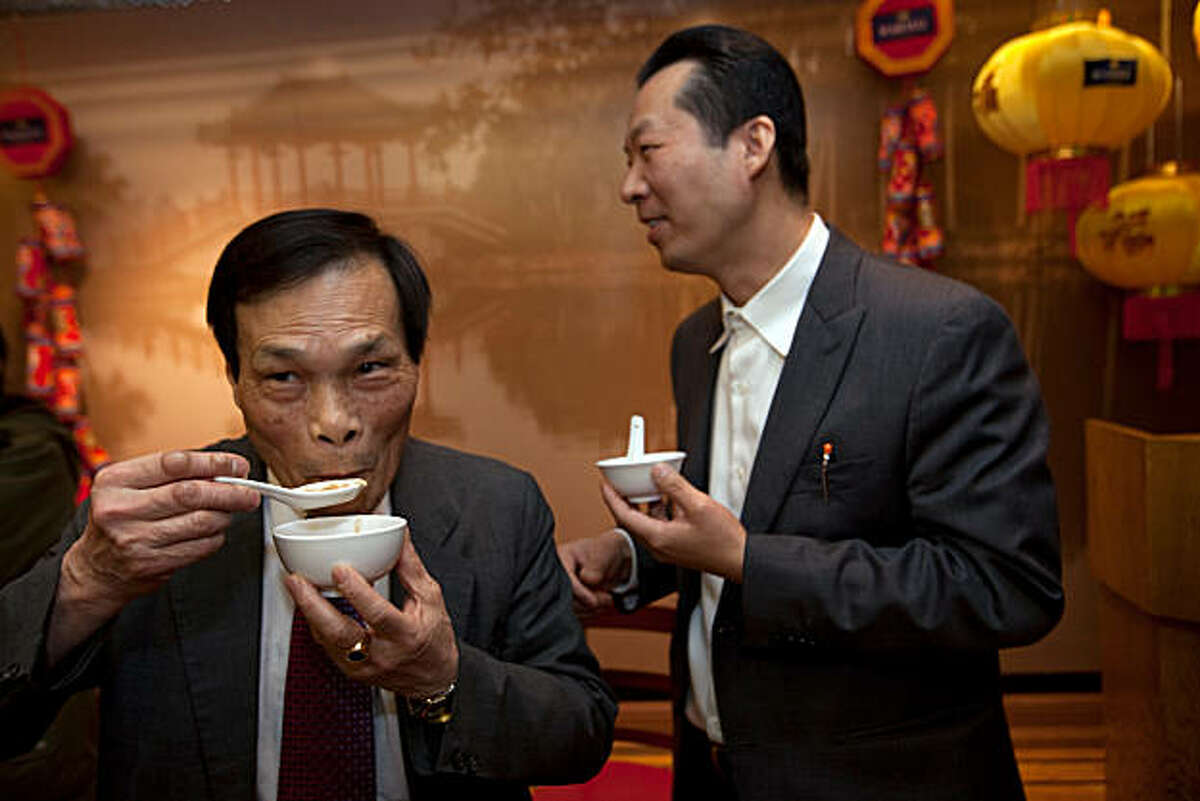 Huan Da Yu, a Chinese herbalist doctor (L) and David Lu (R) enjoy a bowl of shark fin soup at the conclusion of a press conference at the Far East Cafe regarding a bill that has been introduced by legislators to ban the possession, sale and distribution of shark fins used in a traditional Chinese soup on February 14, 2011 in San Francisco Calif. Photograph by David Paul Morris/Special to the Chronicle