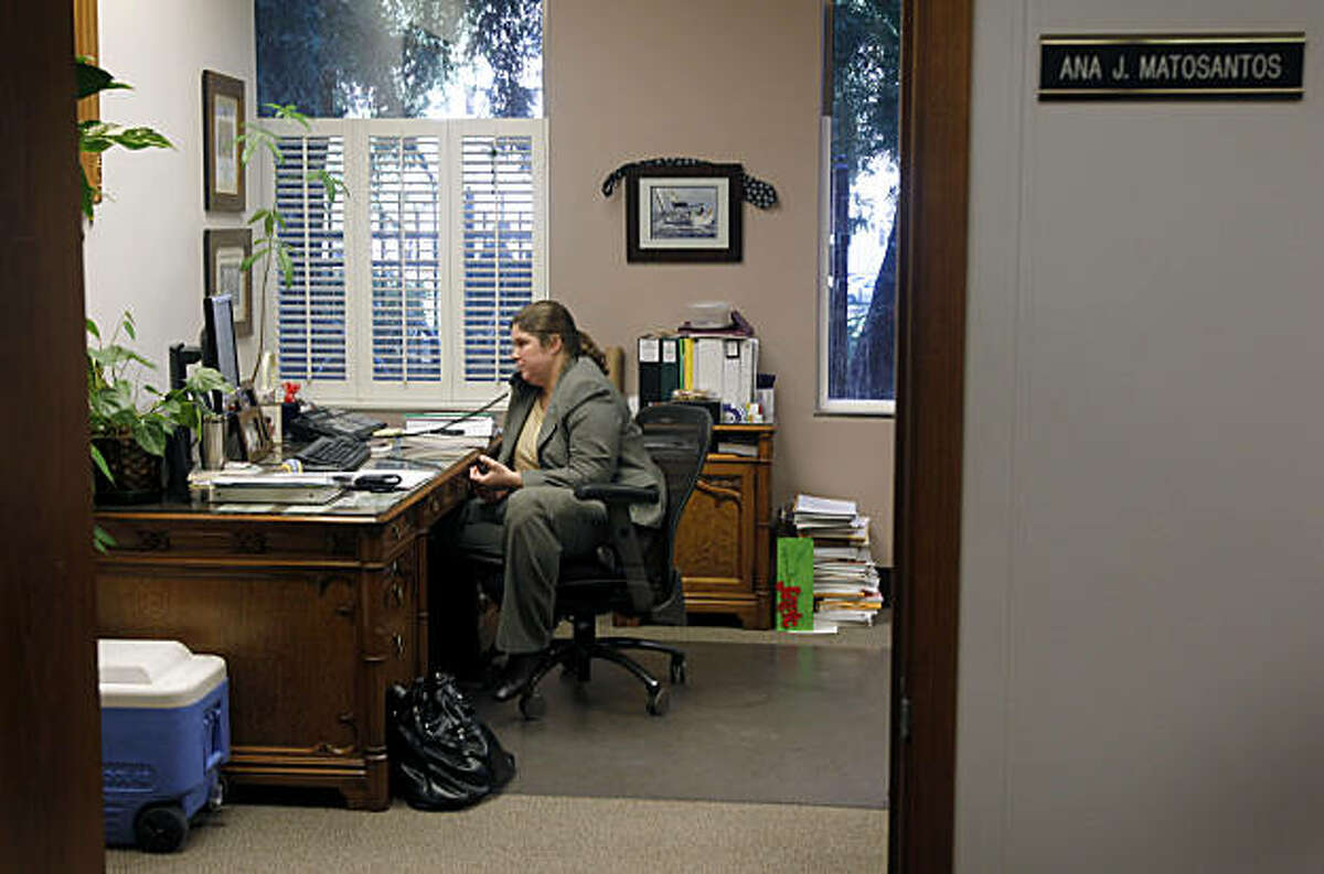 Ana Matosantos, the director of the California Department of Finance, takes a call from Governor Jerry Brown in her office at the State Capitol in Sacramento, Calif., on Wednesday, Feb. 16, 2011.