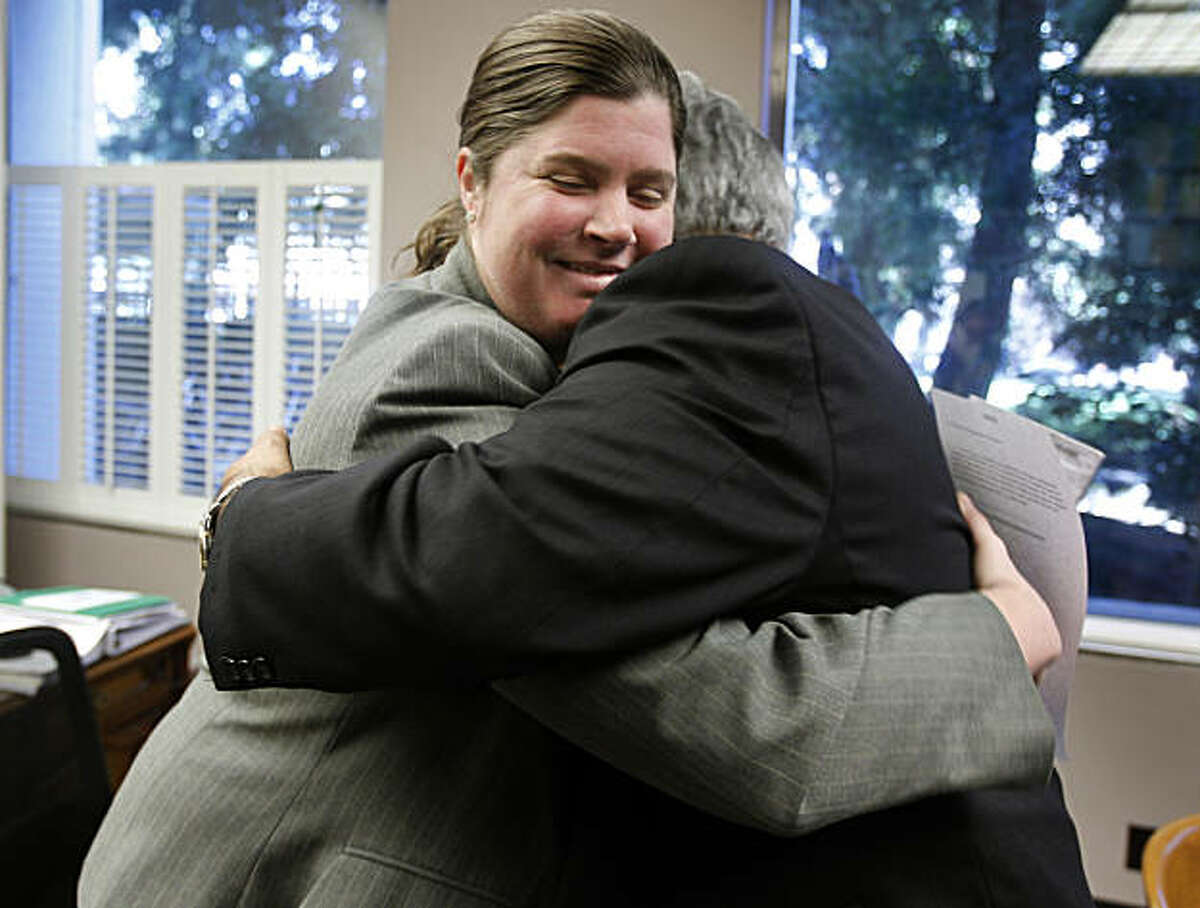 Ana Matosantos, the director of the California Department of Finance, hugs Pedro Reyes, after he was sworn-in as the department's chief deputy director for policy, at the State Capitol in Sacramento, Calif., on Wednesday, Feb. 16, 2011.