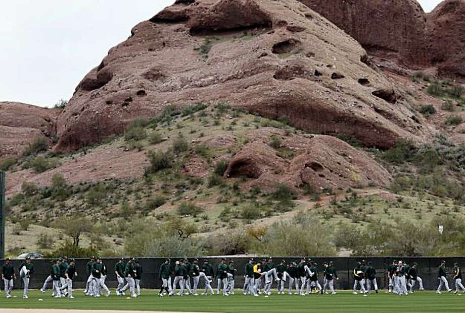 The Oakland Athletics work out beneath the Papago mountains Saturday February 27, 2010. Annual spring training action with the San Francisco Giants and Oakland Athletics from Scottsdale and Phoenix, Arizona. Photo: Brant Ward, The Chronicle