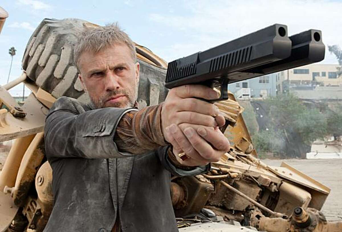 In this film publicity image released by Columbia Pictures, Christoph Waltz is shown in a scene from