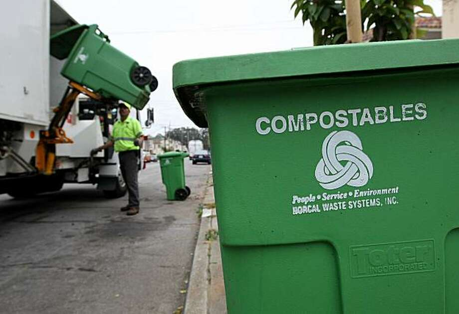 SAN FRANCISCO - JUNE 11:  Norcal Waste worker Manuel Vera dumps a bin with compostable materials into a truck while collecting recyclable materials in a Sunset district neighborhood June 11, 2009 in San Francisco, California. The San Francisco Board of Supervisors voted 9-2 on June 9, 2009 to pass the nation's toughest recycling law for the city of San Francisco. City residents will be issued three bins, one for garbage, one for recycling and one for compostable materials and will be expected to separate their waste in the proper bins for garbage collection. Those who do not properly separate their garbage will be fined $100. San Francisco currently recycles 72 percent of the city's waste and hopes to increase that number to 100 percent by 2020.  (Photo by Justin Sullivan/Getty Images) Photo: Justin Sullivan, Getty Images