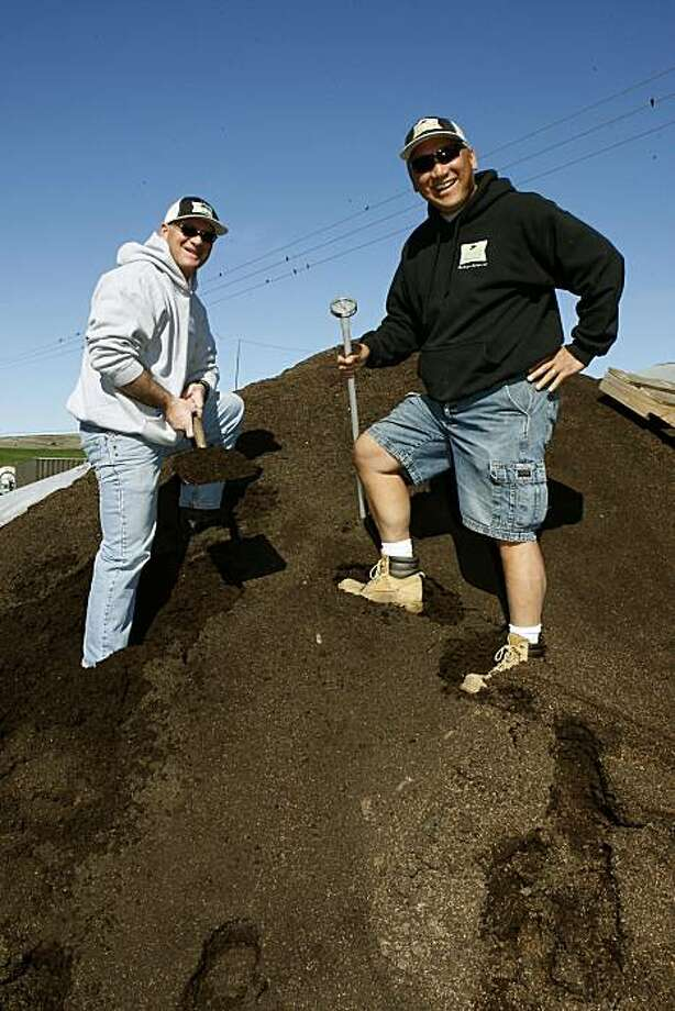 Company head Teddy Stray (left) and director of operations Robert Fontanilla (right) on top of finished compost for Point Reyes Compost Co., in Point Reyes, Calif.  They make their compost from manure coming from organically raised cows.  These cows also provide milk for Point Reyes Farmstead Cheese. Photo: Liz Hafalia, The Chronicle