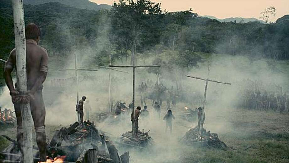 In the film within a film in EVEN THE RAIN (Tambien La Lluvia), the production's biggest scene depicts the natives of the New World burned on crosses by 15th century Spanards. Photo: Courtesy Of Moreno Films