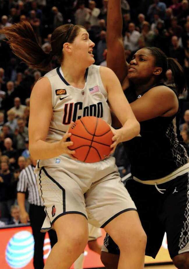Connecticut's Stefanie Dolson comes in for a sho as Providence's Lauren Okafoir defends during the first half of an NCAA college basketball game in Hartford, Conn., Tuesday, Jan. 10, 2012, in Hartford, Conn. (AP Photo/Bob Child) Photo: Bob Child, Associated Press / FR170410 AP