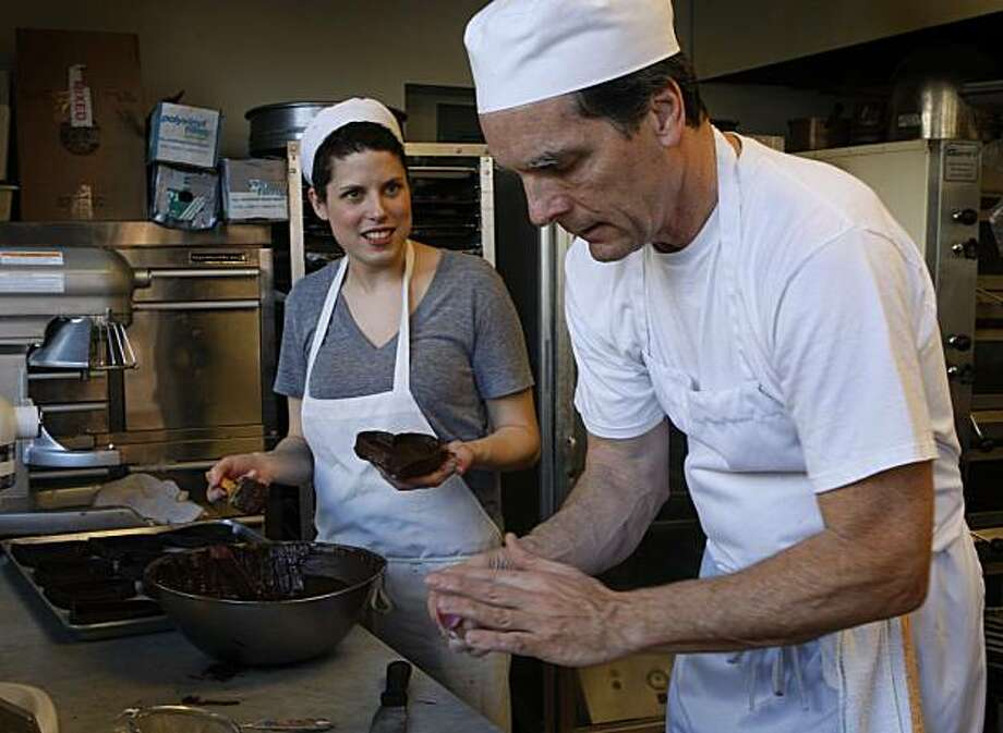 Elena Besagio-Carpenter and her father Doug Besagio work in the kitchen of their Fillmore Bakeshop in San Francisco, Calif., on Tuesday, Jan. 25, 2011. Photo: Paul Chinn, The Chronicle