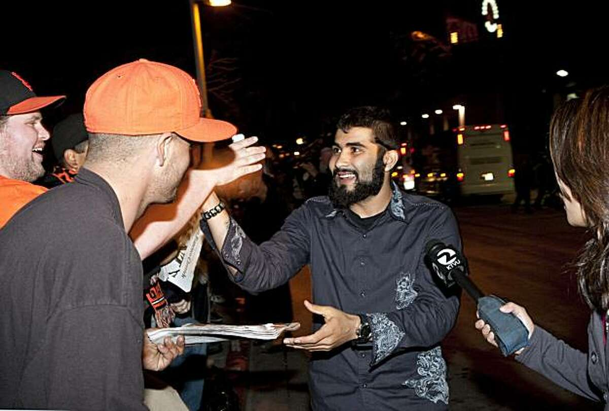 Sergio Romo greets fans outside AT&T Park after returning home from the World Series early in the morning San Francisco, Calif., on Tuesday, November 2, 2010.