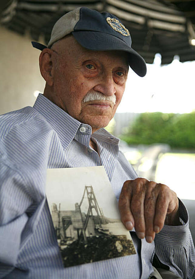 97-year old Harry Fogle, one of the last original workers who worked on the Golden Gate Bridge, holds a photo of the Golden Gate Bridge while it was being built on Thursday August 6, 2010 in Citrus Heights, Calif. Fogel worked as a painter. Photo: Jasna Hodzic, The Chronicle