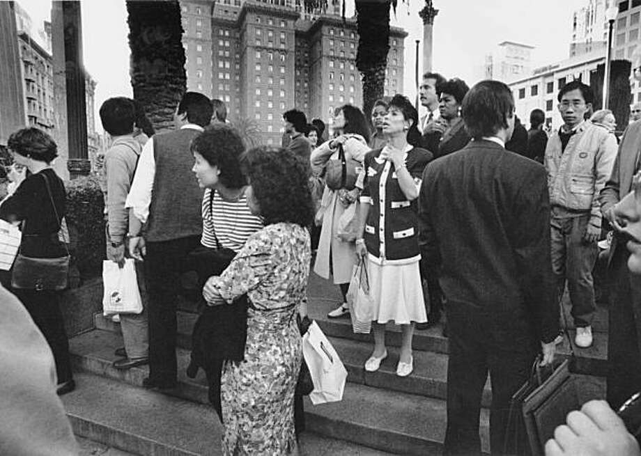 People standing in the middle of Union Square, with the St. Francis Hotel the the background, on Oct. 17, 1989 of Loma Prieta Earthquake. Photo: Scott Sommersdorf, The Chronicle