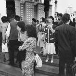 People standing in the middle of Union Square, with the St. Francis Hotel the the background, on Oct. 17, 1989 of Loma Prieta Earthquake.