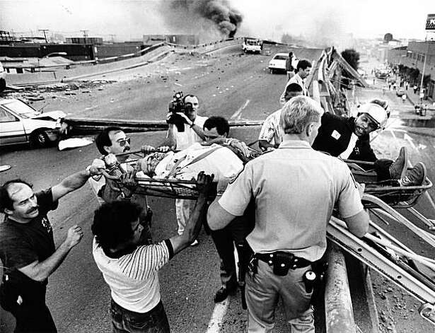 In this photo from October 17, 1989, Oakland Firefighters, California Highway Patrol, and others evac