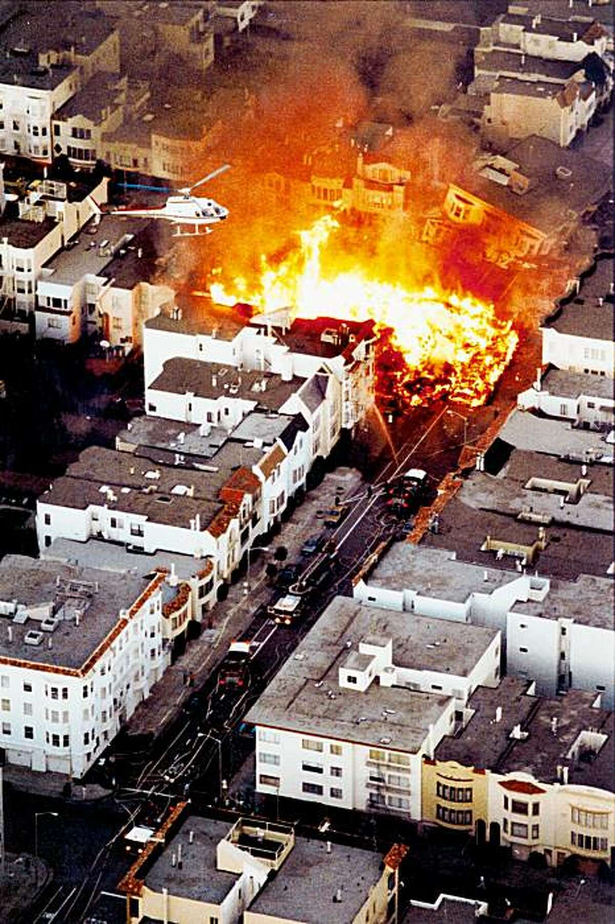 In this photo taken Tuesday, Oct. 17, 1989, a fire burns in the Marina District after the Loma Prieta earthquake in San Francisco.