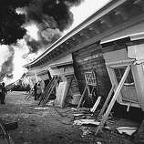 A three story building collapsed  and burned  at Beach and Divisadero in the Marina district in San Francisco after the Loma Prieta earthquake.