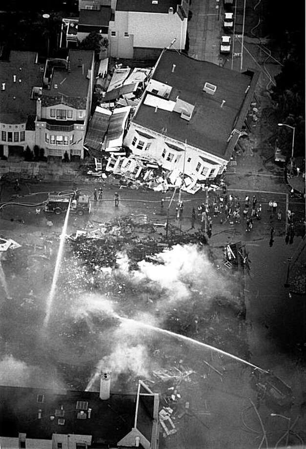 The Marina district of San Francisco had problems getting water to fight the fires on several buildings after the Loma Prieta earthquake. Photo: Deanne Fitzmaurice, The Chronicle