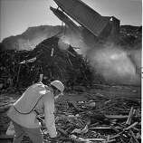 A man sifts threw some of the landfill from the Marina District. San Francisco, Loma Prieta earthquake.