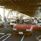 In this photo taken Oct. 17, 1989, motorists turn their cars around and wait to drive back to San Francisco after the upper deck of the Bay Bridge collapsed onto the lower deck in the Loma Prieta earthquake in San Francisco. Saturday is the 20th anniversary of the Loma Prieta earthquake that killed 63 people, injured almost 3,800 and caused up to $10 billion damage.(AP Photo/George Nikitin)