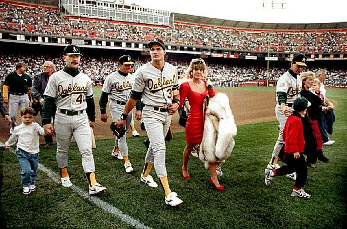 In this photo taken October 17, 1989, Oakland A's Jose Canseco walks off the field with his wife Ester and other A's players before the start of the World Series at Candlestick Park in San Francisco.