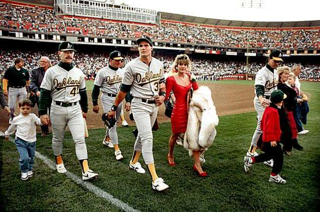 In this photo taken on Oct. 17, 1989, Oakland A's Jose Canseco walks off the field with his wife Ester  and other A's players before the start of the World Series at Candlestick Park in San Francisco. Oct. 17, 2009. Candlestick Park, home of many S.F. memories, will be turned into a shopping development when the 49ers move to Santa Clara. Photo: Dan Rosenstrauch, AP