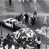 San Francisco Police and baseball officials gather to discuss their plan of action in the moments following the Loma Prieta Earthquake during game 3 of the World Series on October 17, 1989, at Candlestick Park in San Francisco, Calif.