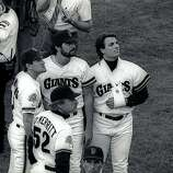 Pitching consultant Marty DeMerritt (52), Kirt Manwaring (left), Steve Bedrosian (beard) and Dave Dravecky gather on the field in the moments following the Loma Prieta Earthquake during game 3 of the World Series on October 17, 1989, at Candlestick Park in San Francisco, Calif.