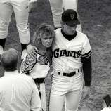 Oakland Athletics and San Francisco Giants players gather on the field with family and friends in the moments following the Loma Prieta Earthquake during game 3 of the World Series on October 17, 1989, at Candlestick Park in San Francisco, Calif.