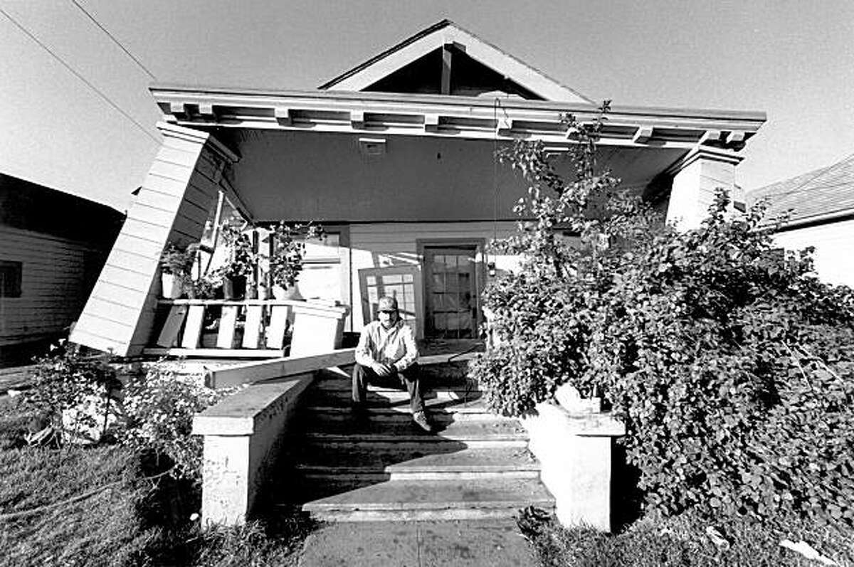 Gillermo Vega in front of his damaged home in Watsonville, Ca. after the Loma Prieta earthquake, October 17, 1989.
