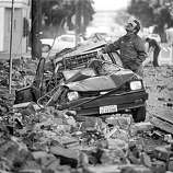 Loma Prieta earthquake caused bricks from buildings to fall on the street and cars in San Francisco. October 18, 1989