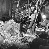 Workers remove the lighting grid at the damaged Geary Theater in San Francisco after the Loma Prieta earthquake