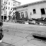An onlooker checks the earthquake damaged homes at Scott and North Point Streets in San Francisco's Marina District,  Loma Prieta Earthquake. 10-21-1989