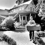 John McMahon helps a friend carry out belongings from his damaged home in Los Gatos, Ca due to the Loma Prieta earthquake, October 17, 1989.