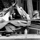 A weary firefighter props his head up as he leans against a tree seated next to a pile of rubble in the Pacific Garden Mall in downtown Santa Cruz on October 20, 1989. Loma Prieta Earthquake