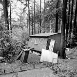 A cabin knocked off it's foundation during the Loma Prieta earthquake, October 17, 1989, in the Santa Cruz mountains.