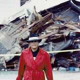A woman carries her belongings out of her devastated neighborhood in this reader-submitted photo from the days after the Loma Prieta earthquake.