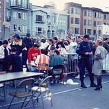 This reader-submitted photo shows a long line of Loma Prieta earthquake victims in need of shelter after the quake made their homes unlivable.