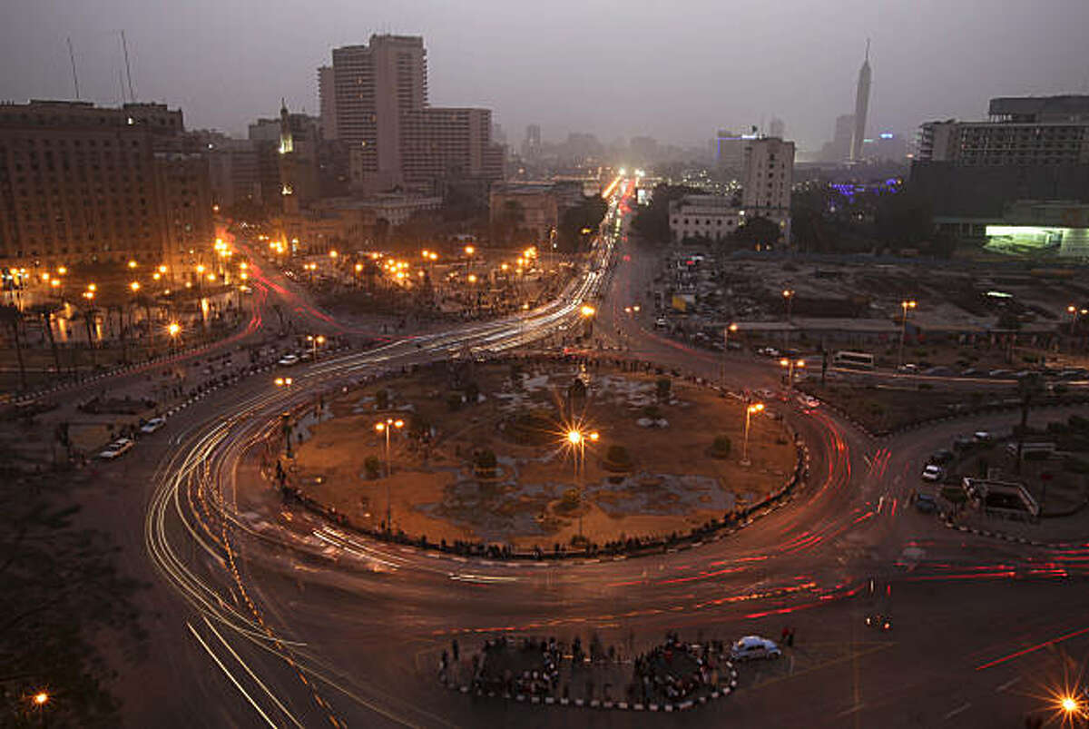 Traffic moves through Tahrir Square in Cairo, Egypt, Tuesday Feb. 15, 2011. Egypt's military is trying to push ahead quickly with a transition after Mubarak resigned Friday in the face of 18 days of popular protests.