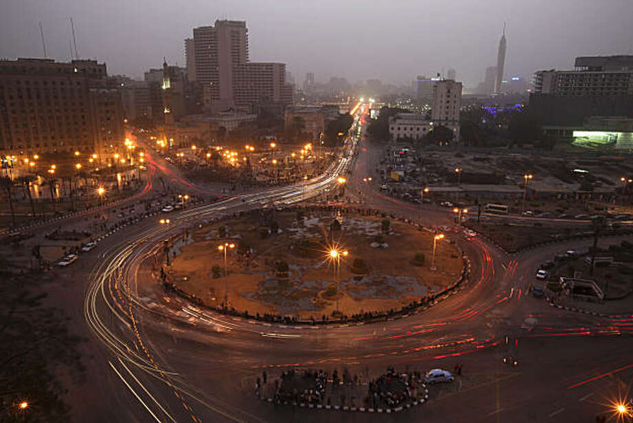 Traffic moves through Tahrir Square in Cairo, Egypt, Tuesday Feb. 15, 2011. Egypt's military is trying to push ahead quickly with a transition after Mubarak resigned Friday in the face of 18 days of popular protests. Photo: Tara Todras-Whitehill, AP