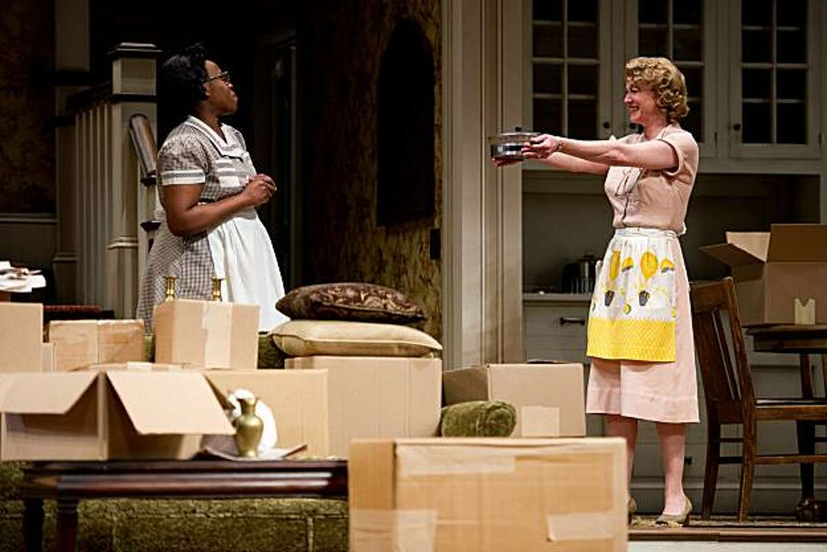 Beverly (Rene Augesen, right) offers a hand-me-down chafing dish to her maid Francine (Omoze Idehenre) in the ACT West Coast premiere of Bruce Norris'