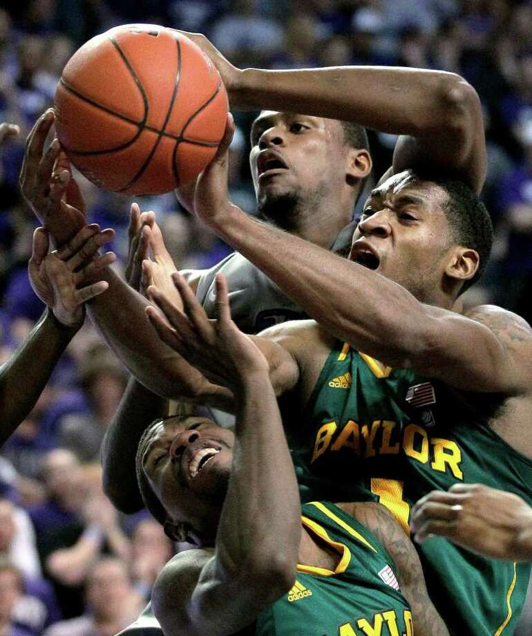 Kansas State's Jordan Henriquez (back) and Baylor's Perry Jones III and A.J. Walton fight for a rebound. Photo: AP
