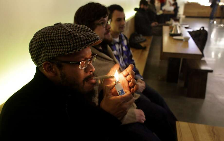 Eugens Warren (left), Nick Smilgys and Harley Melson light up a joint at SPARC (San Francisco Patient and Resource Center), a medical marijuana dispensary in San Francisco. Photo: Lacy Atkins, The Chronicle