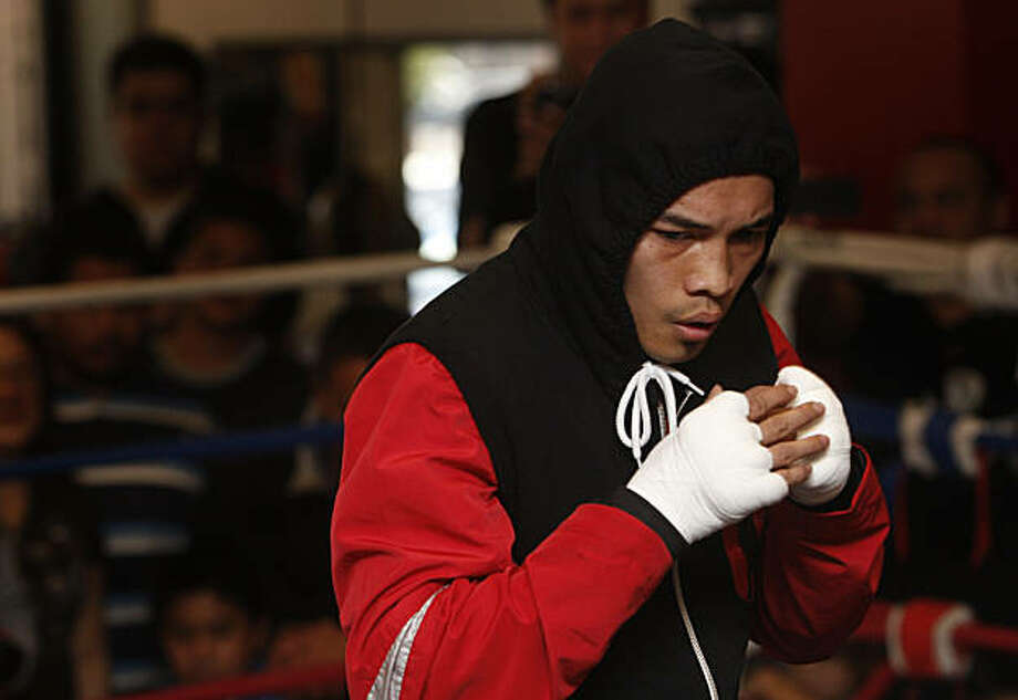 "Professional boxer Nonito Donaire, of San Leandro, nicknamed ""The Filipino Flash"", warms up during a public workout session open to fans at Undisputed Boxing Gym in San Carlos, Calif., on Saturday, February 5, 2011. Photo: Thomas Levinson, The Chronicle"