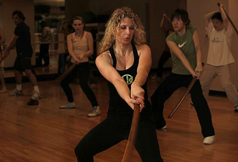 "Chantal Dominique Anderson works out in a fitness class at Sports Club LA San Francisco, on  Tuesday, January 18, 2011, in downtown San Francisco, Calif. Her Healthy Obsession is participating in a ""Jungshin"" class that mixes fitness using wooden swords. Photo: Michael Macor, The Chronicle"