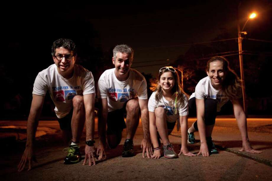 It's runners to their mark for Team Berry, a group of more than 100 taking part in the Chevron Houston Marathon this weekend to assist the Berry family. From left are Marc Feldman, Mark Strug, Julia Strug, and Gavriella Roisman. Photo: Eric Kayne / © 2011 Eric Kayne