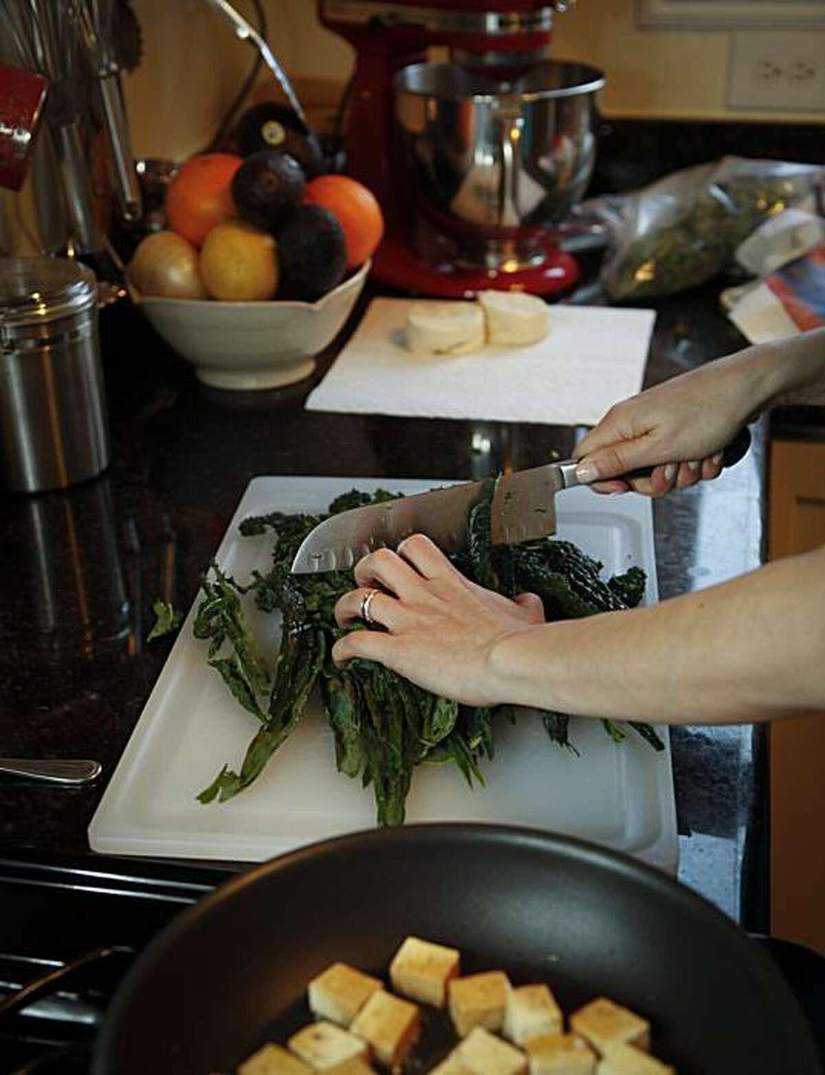 Chronicle Food writer Amanda Gold prepares a weeknight meal of Seared Tofu and Crispy Kale Salad on Monday, Jan. 31, 2011 in San Francisco, Calif.