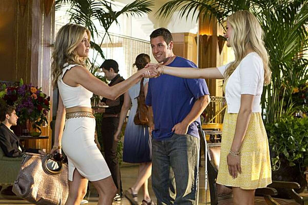 Danny (Adam Sandler, center) introduces his assistant Katherine (Jennifer Aniston, left) as his soon to be ex-wife Devlin to Palmer (Brooklyn Decker) in Columbia Pictures' comedy JUST GO WITH IT.