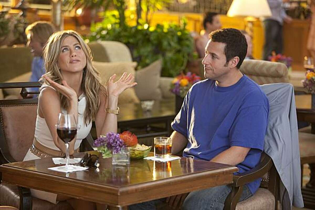 """In this film publicity image released by Columbia Pictures, Jennifer Aniston, left, and Adam Sandler are shown in a scene from """"Just Go with It."""""""