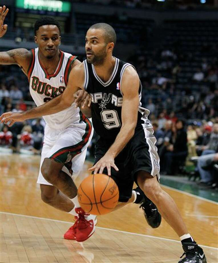 San Antonio Spurs' Tony Parker, right, drives against Milwaukee Bucks' Brandon Jennings during the first half of an NBA basketball game Tuesday, Jan. 10, 2012, in Milwaukee. (AP Photo/Jeffrey Phelps) Photo: Associated Press