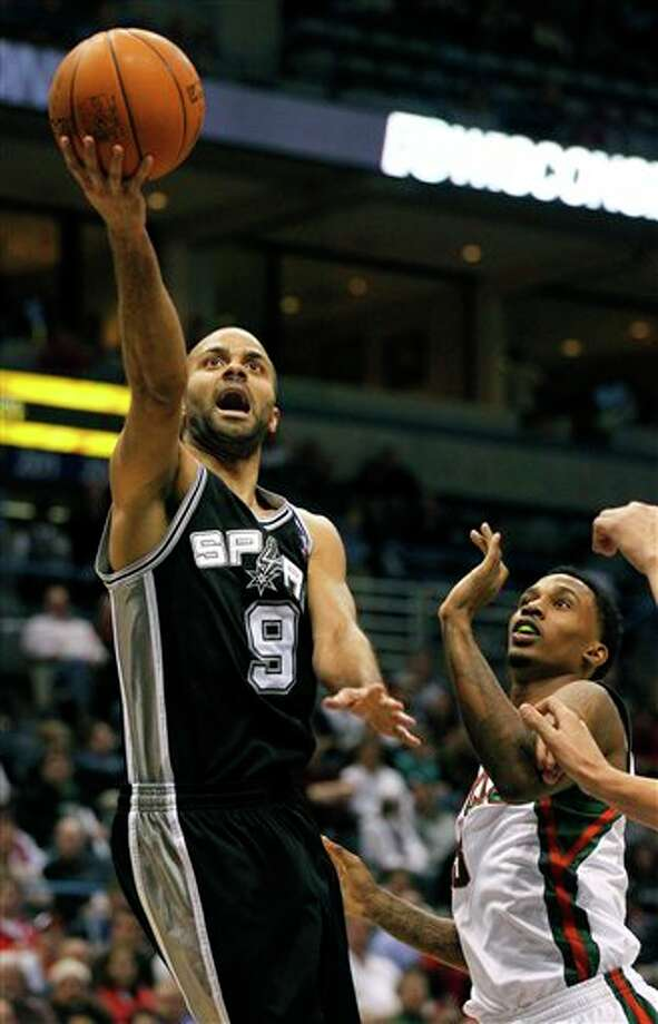 San Antonio Spurs' Tony Parker, left, of France, drives against Milwaukee Bucks' Brandon Jennings during the first half of an NBA basketball game, Tuesday, Jan. 10, 2012, in Milwaukee. (AP Photo/Jeffrey Phelps) Photo: Associated Press