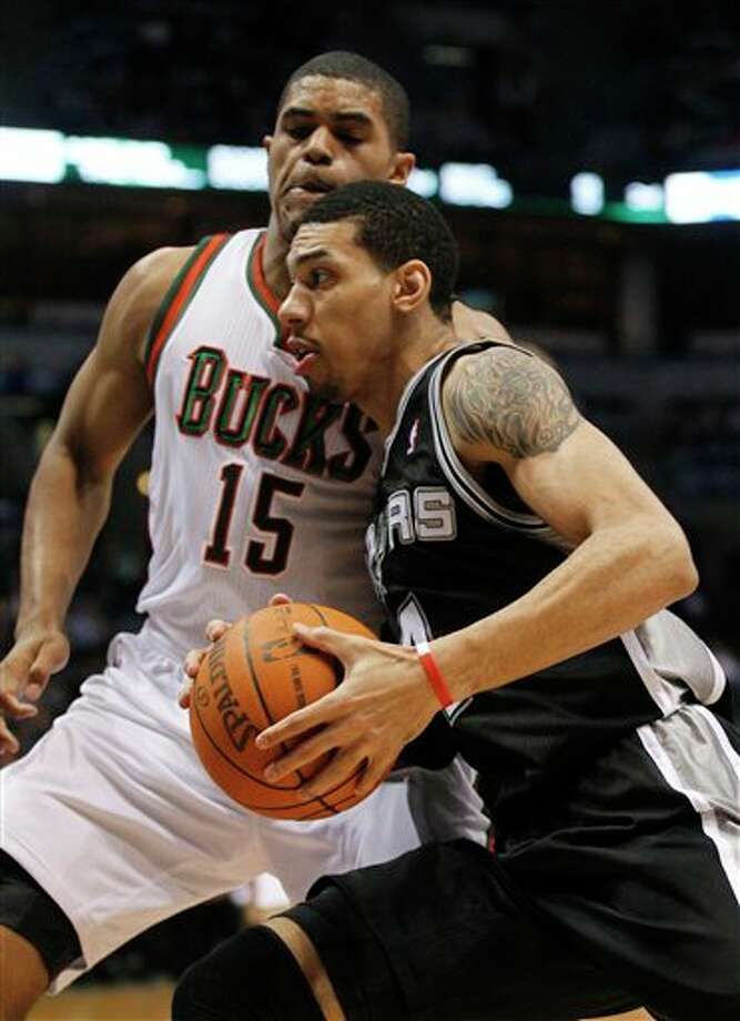 San Antonio Spurs' Danny Green, right, drives against Milwaukee Bucks' Tobias Harris during the first half of an NBA basketball game Tuesday, Jan. 10, 2012, in Milwaukee. (AP Photo/Jeffrey Phelps) Photo: Associated Press