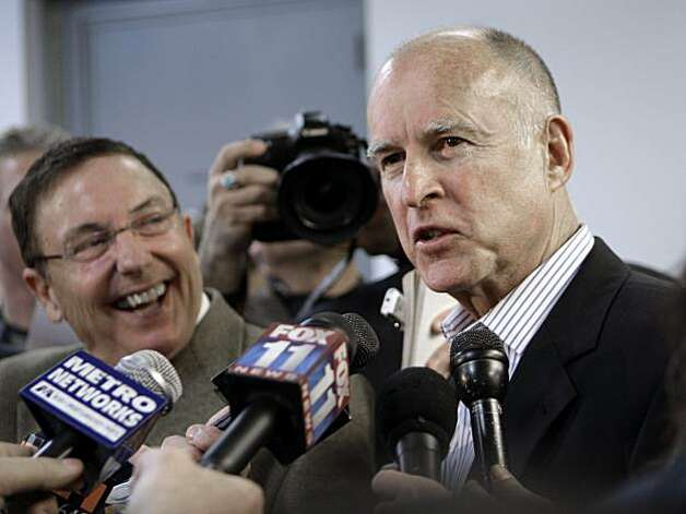 California Gov. Jerry Brown talks to reporters as he arrives at Bob Hope Airport in Burbank, Calif., Thursday, Feb. 10, 2011. Photo: AP