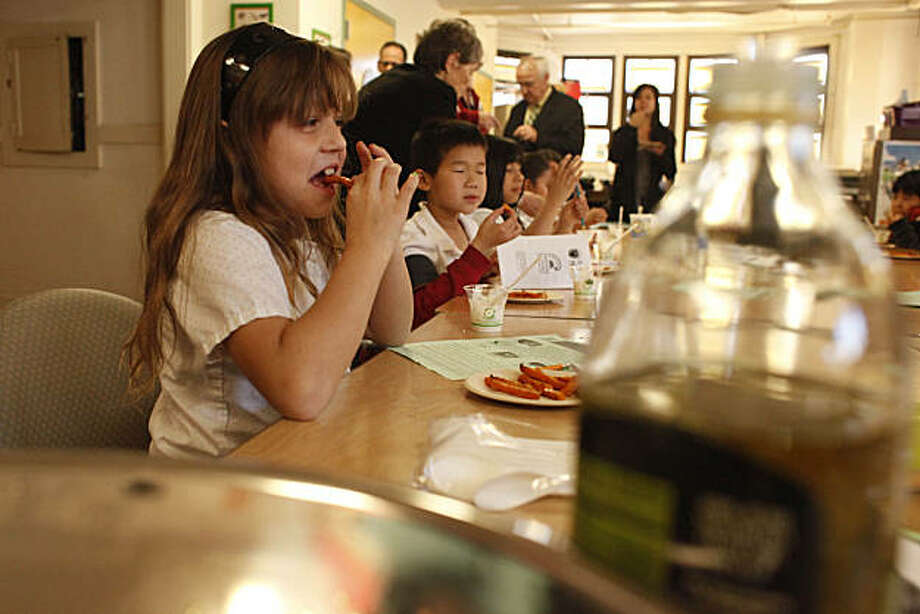 "E. R. Taylor Elementary School Third Grader Estefania Cervera, 8, tries out a sweet potato fry during a cooking demonstration at E.R. Taylor Elementary School during a visit by USDA Food, Nutrition and Consumer Services Under Secretary Kevin Concannon to the school to see how the school exemplifies First Lady Obama's ""Let's Move"" campaign on Tuesday, February 8, 2011 in San Francisco, Calif. Photo: Lea Suzuki, The Chronicle"